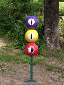 "Concrete ""billiard ball"" house numbers"