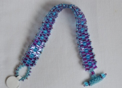 Purple and aqua woven bracelet