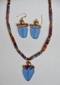 Blue and gold batik fabric bead necklace with recycled glass pendant and matching earrings