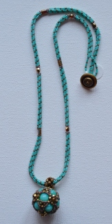 Turquoise and bronze beaded pendant on a woven rope